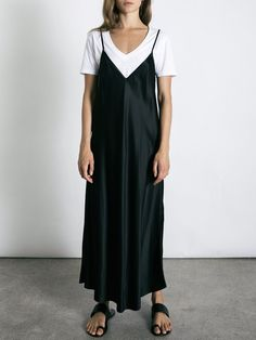 The Technopriest Slip Dress from Australian designer Ellery, is the essential classic 90s style slip.Featuring a sheath silhouette with a V-neckline, this mid length dress is made from 100% silk and is flattering as it falls over the body. An essential piece that can be worn on it's own or layered with a t-shirt or long sleeve and also under jumpers and jackets.DetailsColour: BlackMaterial: 100% Silk UnlinedMid length hem Slips on, not opening or fasteningsMade in Australia V-Neckline Th...