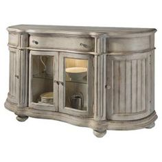 Hand-painted sideboard with fluted details   Product: SideboardConstruction Material: Radiata hardwood solids, New Zealand pine veneer and glassColor: Antique linenFeatures:  Hand-paintedTime-worn appeal Fluted posts and crown moldings Dimensions: 40 H x 66.5 W x 20.25 D