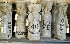 Burlap Wine Bags DIY-tutorial with paint and stencils.  Could maybe do this with burlap run through printer?