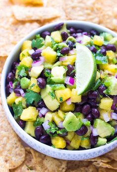 Fresh sweet chunks of pineapple combined with black beans and creamy avocado to make this over the top delicious salsa! | littlebroken.com @littlebroken.com
