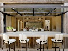 Kitchen opens up to patio bar --- clever! Mediterranean Kitchen by Ken Linsteadt Architects