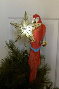 Mouse over image to zoom SCARLET-MACAW-parrot-ILLUMINATED-CHRISTMAS-TREE-TOPPER  SCARLET-MACAW-parrot-ILLUMINATED-CHRISTMAS-TREE-TOPPER Have one to sell? Sell now SCARLET MACAW parrot ILLUMINATED CHRISTMAS TREE TOPPER