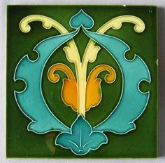 "Colorful and original English Art Nouveau tile c 1900. Measures 6"" square. The lines of the design are raised and the colors rich. Some nicks around the edges. Unsigned."