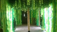 Vines hanging down are cheap plastic tablecloths. Paper chains for the tree leaves. Tree trunk......carpet roll.....VBS 2015.....jungle.....rainforest