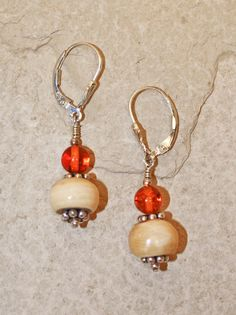 """Handmade ancient mammoth ivory bead earrings, set with sterling silver clasps, and smaller amber bead. Size: 1 5/8""""H Including Clasp  Price: $45.00 -- on ScrimshawGallery.com #jewelry #earring #ivory"""