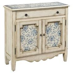 "Hall chest with a warmly weathered finish.Product: Hall chest Construction Material:  Wood Color: Distressed cream  Features: One adjustable shelfOne drawer and two doorsDimensions: 35"" H x 36"" W x 12"" D"