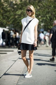 Pin for Later: 30 Days of Outfits to Kick-Start Your September Fall Street Style Easy Autumn days call for easy styling — like a skirt finished with slip-on kicks.