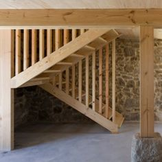 A new internal framework of wooden columns, beams and staircases provides a warm contrast to the rough stone walls of this old farmhouse in rural Spain. Narrow Staircase, Wood Staircase, Open Stairs, Stair Ladder, Wooden Columns, Narrow House, Wood Architecture, Spanish Style Homes, Farmhouse Design