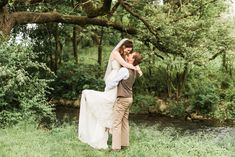 Photo of groom carrying bride at their woodland wedding by Alysha Christine Photography