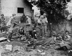 German and US Medics Tend Wounded German POWs in St. Lo Normandy 1944