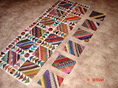 Working a lot again, so not much progress on the quilting front. Above is my latest string thing quilt. I have...