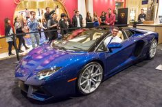 Eighteen time Olympic Gold Medal winner Michael Phelps tries on the new Aventador Roadster during a charity event for One Drop, in Las Vegas. Lamborghini Aventador Interior, Lamborghini Veneno, Car Photos, Car Pictures, My Dream Car, Dream Cars, Gold Medal Winners, Olympic Gold Medals, Michael Phelps