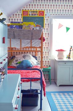 Fun fun fun kid's room! Love the mix of softened but vibrant colors and painted furniture pieces