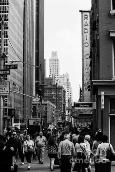Radio City at 49th Street A typical day in New York City, as a sea of humanity moves along Radio City at 49th street.