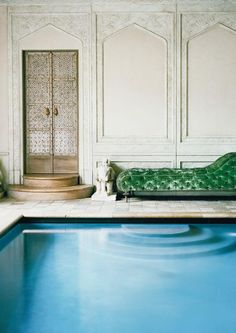 because if I ever have an indoor pool I'll definitely accessorize it with a tufted velvet chaise. Ann Getty Residence