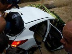 Buscan ocupantes de yipeta arrastrada por cañada tras fuertes lluvias en Puerto Plata