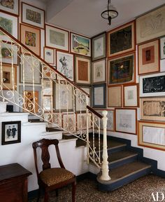 The villa's staircase boasts works by Pablo Picasso, max Ernst, Giorgio De Chirico, and Antonio Sant'Elia hanging alongside pieces by Baj.