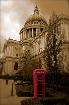 St Pauls Cathedral and Red Telephone box. Photograph by John Colley http://fineartamerica.com/featured/st-pauls-and-red-telephone-box-john-colley.html