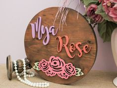 Decorate your baby girl's nursery with these custom circle wood sign that can be personalized wi