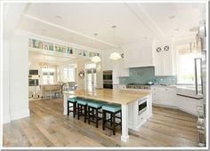 love the light wood floors with white cabinets.