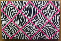 Complete your Zebra decor with a functional Zebra decorative cork fabric covered Bulletin Board.  This one is with hot pink criss cross ribbons.