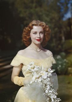 Actress Arlene Dahl looking beautiful in pale butter yellow. #vintage #1940s #1950s