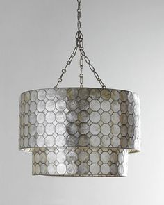 The smoked capiz shell would look awesome with a grey and white color palette! Like GEOS Recycled Glass Surfaces in St. Smoked Capiz Two-Tier Chandelier at Horchow. Lighting Sale, Home Lighting, Entry Lighting, Office Lighting, Kitchen Lighting, Lighting Ideas, 3 Light Pendant, Mini Pendant, Ceiling Canopy