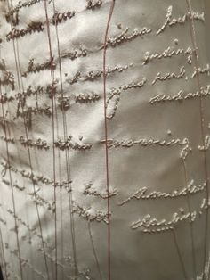 Roslyn Ritter, Love Letters (detail below), seen at FiberArt International, Blogged by Kathleen Loomis. Ritter embroidered the text from her father's letters onto her mother's 1936 wedding dress -- pure simplicity and pure love.