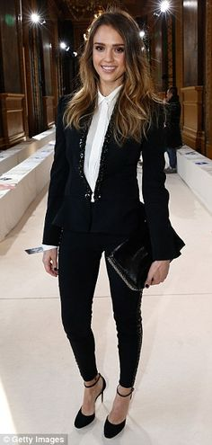 Style star: She dressed to impress in her skinny black trousers and white shirt at the A-list show to kick off the week