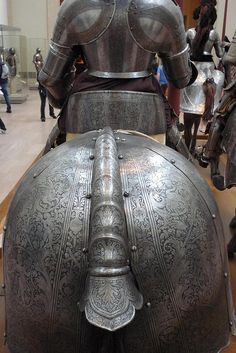 Plate armour of horse and the knight in its saddle, from behind. Shows the crupper and saddle cantle of the horse's armor. Italy,  1570