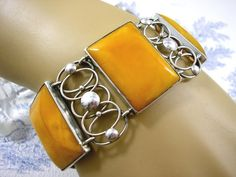 Antique Art Deco Silver Bracelet Honey Amber Bauhaus Design circa 1940s. The Large Antique Amber Sections are the lovely Rich Egg Yolk antique amber set in Solid Silver  Makers Mark Louis Vausch .