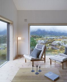 Interior shot of the Cottage--Scandinavian Living Room with Views over Vega Island Landscape