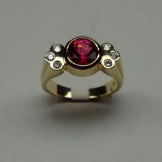Pink Tourmaline diamond ring 14k gold bezel set gift custom design – All Animal Jewelry & Jan David Design Jewelers