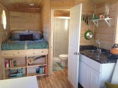 Tiny House – Reduced for Immediate Sale! A platform bed w/ storage underneath it. An article I read recently, advised against ever buying a boxspring, & using all the room under the platform bed for storage. For example, the shelf unit at the end of the bed could be built to swing outward to reveal extra room.