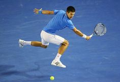MELBOURNE, AUSTRALIA - JANUARY 28 2015Novak Djokovic of Serbia stretches for a backhand in his quarter final match against Milos Raonic of Canada during day 10 of the 2015 Australian Open at Melbourne Park on January 28, 2015 in Melbourne, Australia. (Photo by Scott Barbour/Getty Images)