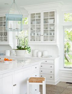 white kitchen...love the blue lighting fixture.