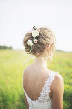 Beautiful updo with floral details: http://www.stylemepretty.com/canada-weddings/manitoba/winnipeg/2014/11/07/rustic-diy-wedding-in-winnipeg/ | Photography: Simply Rosie - http://simplyrosie.ca/
