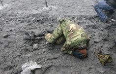 A pro-European protester lies on the ground during a battle with riot police in Kiev, on January 22, 2014. (Reuters/Gleb Garanich