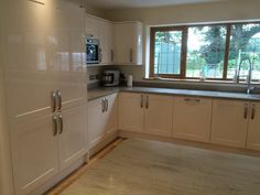 Modern kitchen gloss cream grey worktop Corian Howdens range master country oak floor