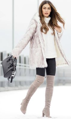 Coloured thigh high boots are always a winner! Lydia Lise Millen wears this gorgeous pastel pair with black jeans, a cream knit sweater, and a stunning faux fur coat from Boohoo. We love this look!  Fur Coat: Boohoo, Jumper: Jigsaw, Bag: Givenchy, Jeans: Paige, Boots: Stuart Weitzman