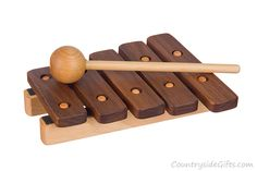 """Our wooden Xylophone is made from fine Maple and Walnut. Each felt backed key makes a wonderful """"bright"""" sound when struck. The included long mallet is perfectly sized for litt… Wooden Toy Trucks, Wooden Baby Toys, Wood Toys, Woodworking Software, Woodworking Crafts, Wooden Educational Toys, Carters Baby Girl, Baby Girls"""