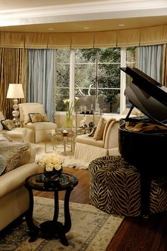 This sophisticated living room manages a baby grand piano with an ottoman bench as well as a cozy conversation nook in a curved window. Its palette of butter yellow and curry gold add warmth with pattern and textures to move the eye. Piano Living Rooms, Living Room With Fireplace, Formal Living Rooms, Family Room Design, Interior Design Living Room, Grand Piano Room, Traditional Family Rooms, Ottoman Design, Sweet Home