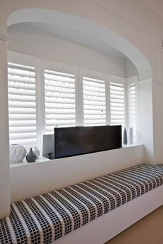 Pop-up plasma TV in bay window seating surrounds. Love the shutters & fabric Bay Window Bedroom, Bay Window Living Room, Tv In Bedroom, Open Plan Kitchen Living Room, Home Living Room, Living Room Designs, Interior Architecture, Interior Design, Space Interiors