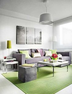 Awesome Interior Design of a Small 40 Square Meter Apartment : Small 40 Square Meter Apartment With White Wall Big Window Chandelier Purple Sofa Pillow Table Cushion Green Carpet Lamp Hardwood Floor