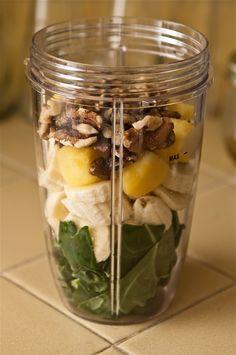 Collards, Banana, Frozen Pineapple, Walnuts, Add Water & a Splash of Coconut Milk & Blend.