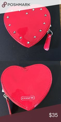 Coach Red Patent coin purse Adorable red patent heart shape coin purse with silver studs and zip top closure.  BNWT, located inside coin purse.  MSRP 78.00 bought for 69.99 Coach Bags Wallets