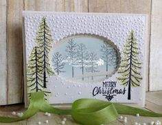 Snowy Christmas...   Rambling Rose Studio   Billie Moan  Paper:  Thick Whisper White Cardstock and Dazzling Diamonds Glimmer Paper Ink:  Old Olive, Basic Black, Soft Sky, VersaMark Stamps:  Thoughtful Branches and Hang Your Stocking (sentiment) Tools 'N Embellishments:  Layered Ovals Framelits, Swirly Bird Framelits, Softly Falling Embossing Folder, Adhesive Strips, Swirly Squibbles Framelits