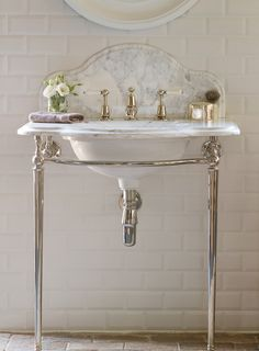 Small Guest Bathroom or Powder Room with a Single Basin Classic Style Washstand with frame in polished silver nickel finish and grey and white Arabascato Marble vanity top and backsplash.