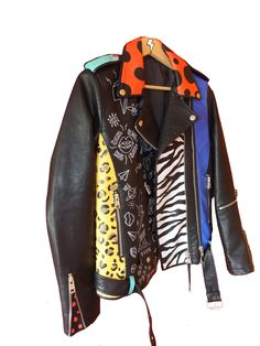 This jacket has a mix of different colors and patterns. From zebra and leopard prints, random doodles and polka dots, this is a very edgy piece you can take with you everywhere!  www.mart-productions.com  Art, hand painted, fashion, leather jacket, unique