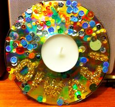 Easy Diwali decoration using a tea-light, old CD and sequins. Happy Divali everyone x